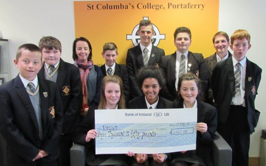 Pupils presenting Rosie Murray from Trocaire with a cheque for £3,050